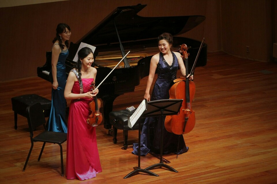 Yeonjin Kim with her sisters performing as K Trio